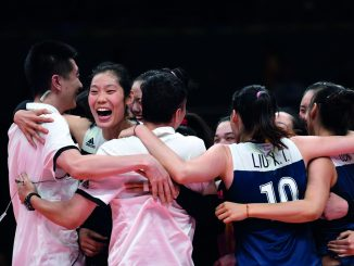 China's players celebrate after winning the women's quarter-final volleyball match between Brazil and China at the Maracanazinho stadium in Rio de Janeiro on August 16, 2016. / AFP PHOTO / Kirill KUDRYAVTSEV